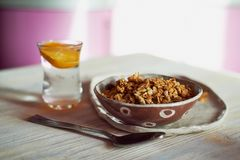 Healthy Breakfast of Champions. Muesli , a glass of water with a slice of orange.Ceramic handmade. Healthy Breakfast of Champions. Muesli , a glass of water with Royalty Free Stock Photography