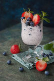 Healthy breakfast with chia seeds and berries. Healthy breakfast.Yogurt with chia seeds  topped with blueberries, strawberry, mint and cereals Stock Images