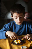 Eating egg for breakfast Royalty Free Stock Photography