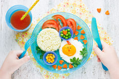 Healthy breakfast for children fried eggs with vegetables Royalty Free Stock Photos