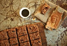 Healthy breakfast with chocolate cake and coffee on a vintage board