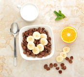 Healthy Breakfast - chocolate cereal with banana royalty free stock photos
