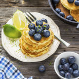 Healthy breakfast classic. Several domestic hot pancakes with fresh ripe blueberry lime zest, honey Royalty Free Stock Photo