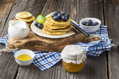 Healthy breakfast classic. Several domestic hot pancakes with fresh ripe blueberry lime zest, honey Stock Images