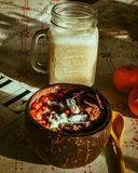 Healthy breakfast in coconut with banana smoothie. royalty free stock photos