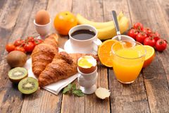 Healthy breakfast with coffee. Croissant and boiled egg Stock Photo
