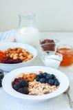 Healthy breakfast concept. Homemade granola muesli with blackb royalty free stock image