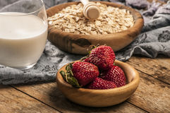 Healthy breakfast concept with oat flakes and fresh berries on rustic background. Food made of granola and musli. Healthy banana smoothie with blackberries Royalty Free Stock Photo