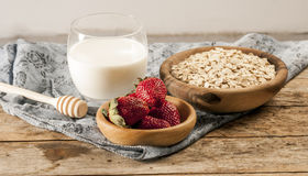 Healthy breakfast concept with oat flakes and fresh berries on rustic background. Food made of granola and musli. Healthy banana smoothie with blackberries Stock Photography