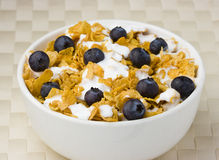 Healthy Breakfast of corflakes and blueberries. Breakfast bowl of cereal with blueberries Royalty Free Stock Images