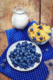 Healthy breakfast with corn flakes, berries (blueberry), milk on Royalty Free Stock Photo