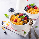 Healthy breakfast with corn flakes and berries. Healthy breakfast with corn flakes, berries and milk on light gray background. Copy space Royalty Free Stock Photo