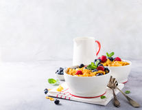 Healthy breakfast with corn flakes and berries. Healthy breakfast with corn flakes, berries and milk on light gray background. Copy space Stock Photography