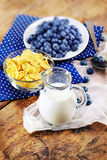Healthy breakfast with corn flakes, berries, milk on wooden back Stock Photography