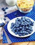 Healthy breakfast with corn flakes, berries, milk on wooden back Royalty Free Stock Photography