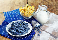 Healthy breakfast with corn flakes, berries, milk on wooden background Royalty Free Stock Photos