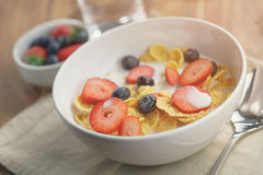 Healthy breakfast with corn flakes and berries in white bowl. Slightly toned photo Royalty Free Stock Photos