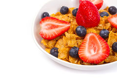 Healthy breakfast with corn flakes and fruits. Healthy breakfast with corn flakes, blueberries and strawberries Stock Image