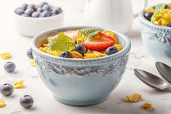 Healthy breakfast - corn flakes with fruits and berries. Healthy breakfast - corn flakes with fruits and berries, selective focus Royalty Free Stock Photos