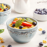 Healthy breakfast - corn flakes with fruits and berries. Healthy breakfast - corn flakes with fruits and berries, selective focus Royalty Free Stock Images