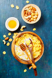 Healthy Breakfast. Corn flakes with nuts and honey. Top view Royalty Free Stock Image