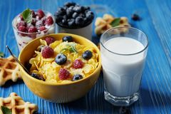 Healthy breakfast. Corn flakes with raspberries and blueberries,. Granola with yogurt and berries, wafers and milk. A great start to the day. Top view. Close up Royalty Free Stock Images
