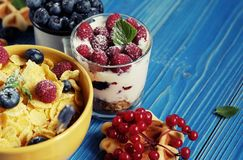Healthy eating and diet concept: Corn flakes with raspberries an. Healthy breakfast. Corn flakes with raspberries and blueberries, granola with yogurt and Stock Photos