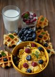 Healthy breakfast. Corn flakes with raspberries and blueberries,. Granola with yogurt and berries, wafers and milk. A great start to the day. Top view. Close up Stock Image