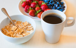 Healthy breakfast. Corn flakes with ripe red strawberry, blue ho Stock Photos