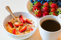 Healthy breakfast. Corn flakes with ripe red strawberry, blue ho Stock Images