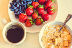 Healthy breakfast. Corn flakes with ripe red strawberry, blue ho Royalty Free Stock Photos