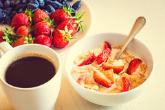 Healthy breakfast. Corn flakes with ripe red strawberry, blue ho Royalty Free Stock Photo