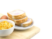 Healthy breakfast: cornflakes with milk and bread Stock Image