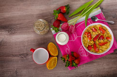 Healthy breakfast cornflakes with milk and fruits Stock Images