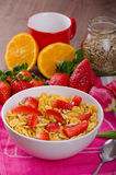 Healthy breakfast cornflakes with milk and fruits Stock Photo
