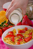 Healthy breakfast cornflakes with milk and fruits Royalty Free Stock Image