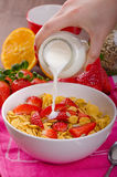 Healthy breakfast cornflakes with milk and fruits Royalty Free Stock Images