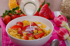Healthy breakfast cornflakes with milk and fruits Royalty Free Stock Photos