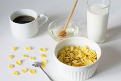 Healthy breakfast with cornflakes and milk over white background royalty free stock photos