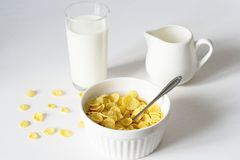 Healthy breakfast with cornflakes and milk over white background royalty free stock photo