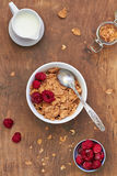 Healthy breakfast. Cornflakes with milk and raspberries Royalty Free Stock Photography