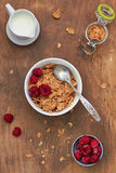 Healthy breakfast. Cornflakes with milk and raspberries Royalty Free Stock Photos