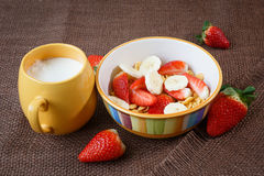 Healthy breakfast. Cornflakes, strawberries and mi Royalty Free Stock Images