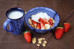 Healthy breakfast. Cornflakes, strawberries and mi Stock Photography