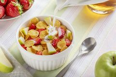 Healthy breakfast cornflakes and strawberries with milk and apple juice. Bio healthy. Close up royalty free stock image