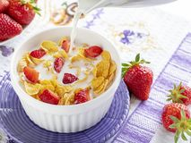Healthy breakfast cornflakes and strawberries. With milk. Bio healthy. Close up royalty free stock image