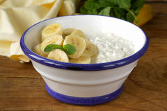 Healthy breakfast cottage cheese with banana Stock Images