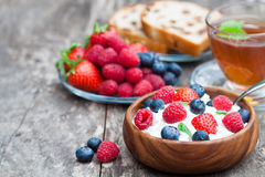 Healthy breakfast cottage cheese with  berries and melissa tea Stock Photo