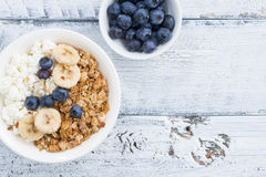 Healthy breakfast with cottage cheese, muesli and fresh fruit Royalty Free Stock Image