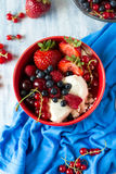 Healthy breakfast: cottage cheese with sour cream, strawberry, raspberry, blueberry, cherry and red currant Stock Photo